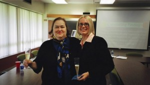 Dr. Lynda Lee Kaid toasts to Dr. Kaye Sweetser at her doctoral defense (May 2004)